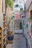 A narrow street with graffiti n Jerusalem, Israel, Middle East.