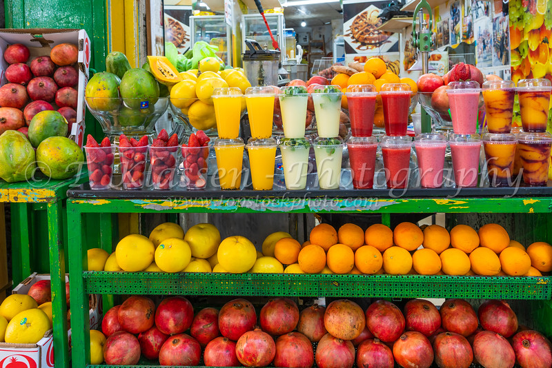 A colorful fruit stand selling fruit juices in the old city of Jerusalem, Israel, Middle East.