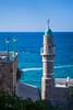 The Al-Gahr Mosque and minaret on the Ha`aliya Hashniya harbor in the old city of Jaffa, Tel Aviv, Israel, Middle East.