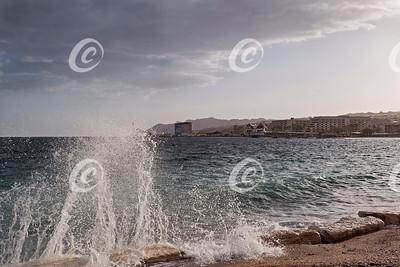 Setting Sun Lights up Breaker Spray in Eilat in Israel