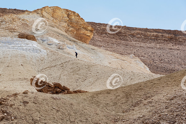 Hiker Trudging up a Steep Desert Trail in the Negev in Israel