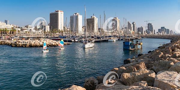 Sailboats, a Dredger and Resort Hotels at the Tel Aviv Marina in Israel