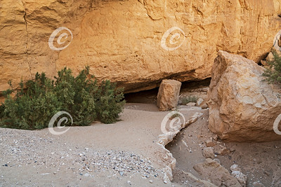 Nearly Hidden Entrance to the Nekarot Cave in the Makhtesh Ramon Crater in Israel