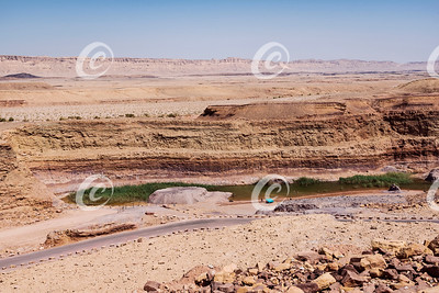People Enjoying the Pond Formed by the Old Clay Quarry in the Makhtesh Ramon Crater in Israel