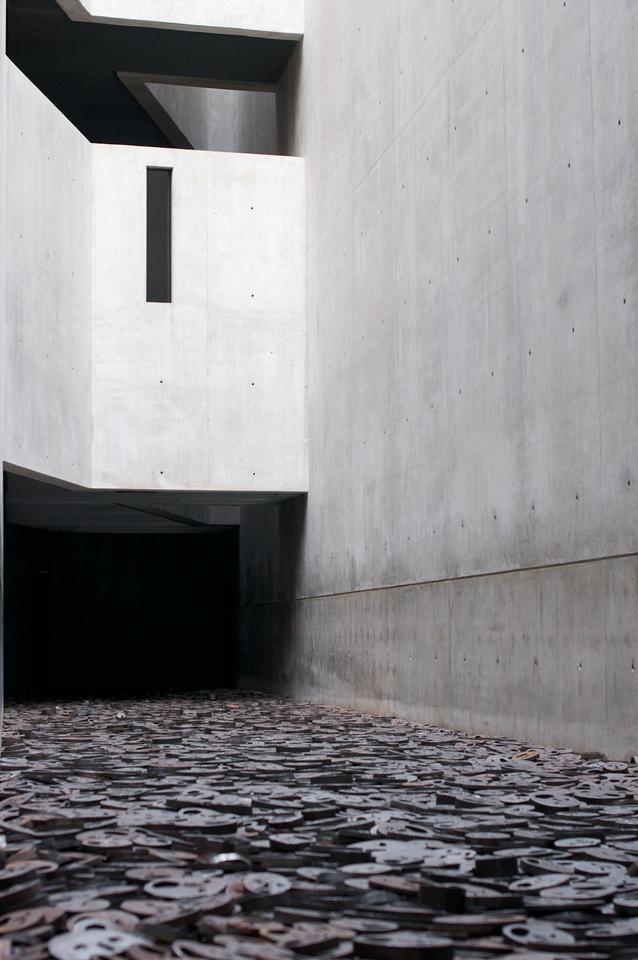 "The Israeli artist Menashe Kadishman's steel sculpture ""Shalechet"" (Fallen Leaves) covers the entire floor of one of the five Voids."