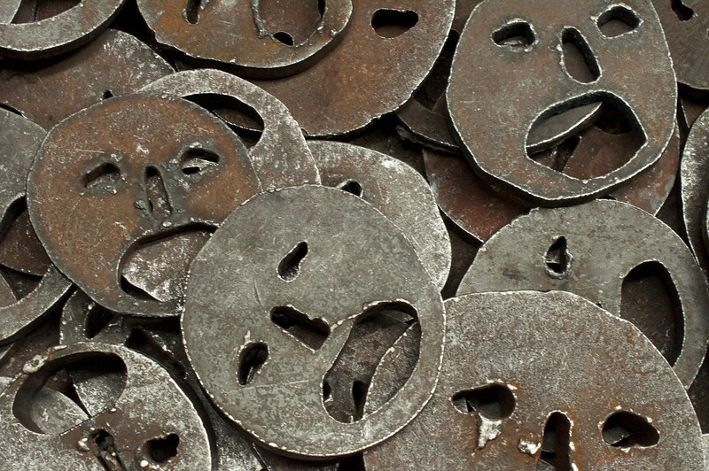 The fallen leaves are heavy metal faces that make unhman noises when walked on The haunting faces conjure a feeling of pain and great loss,