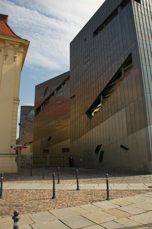 The architect, Daniel Libeskind, has named the new building-exhibit 'Between the Lines' because it is about two lines of thinking, organization and relationship. One is a straight line, but broken into many fragments, the other is a tortuous.