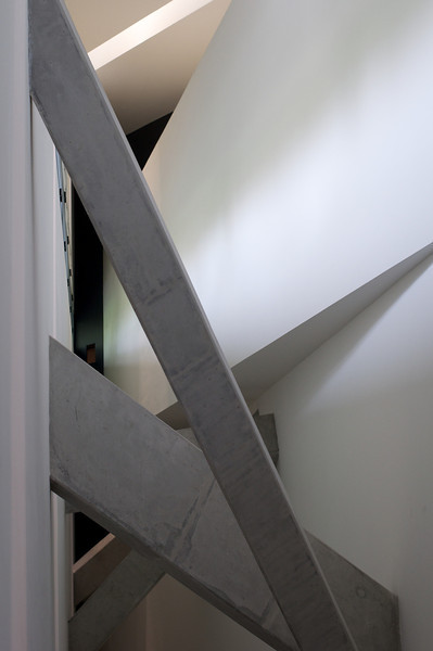 Concrete structure at the top of very high walls and ceiling.