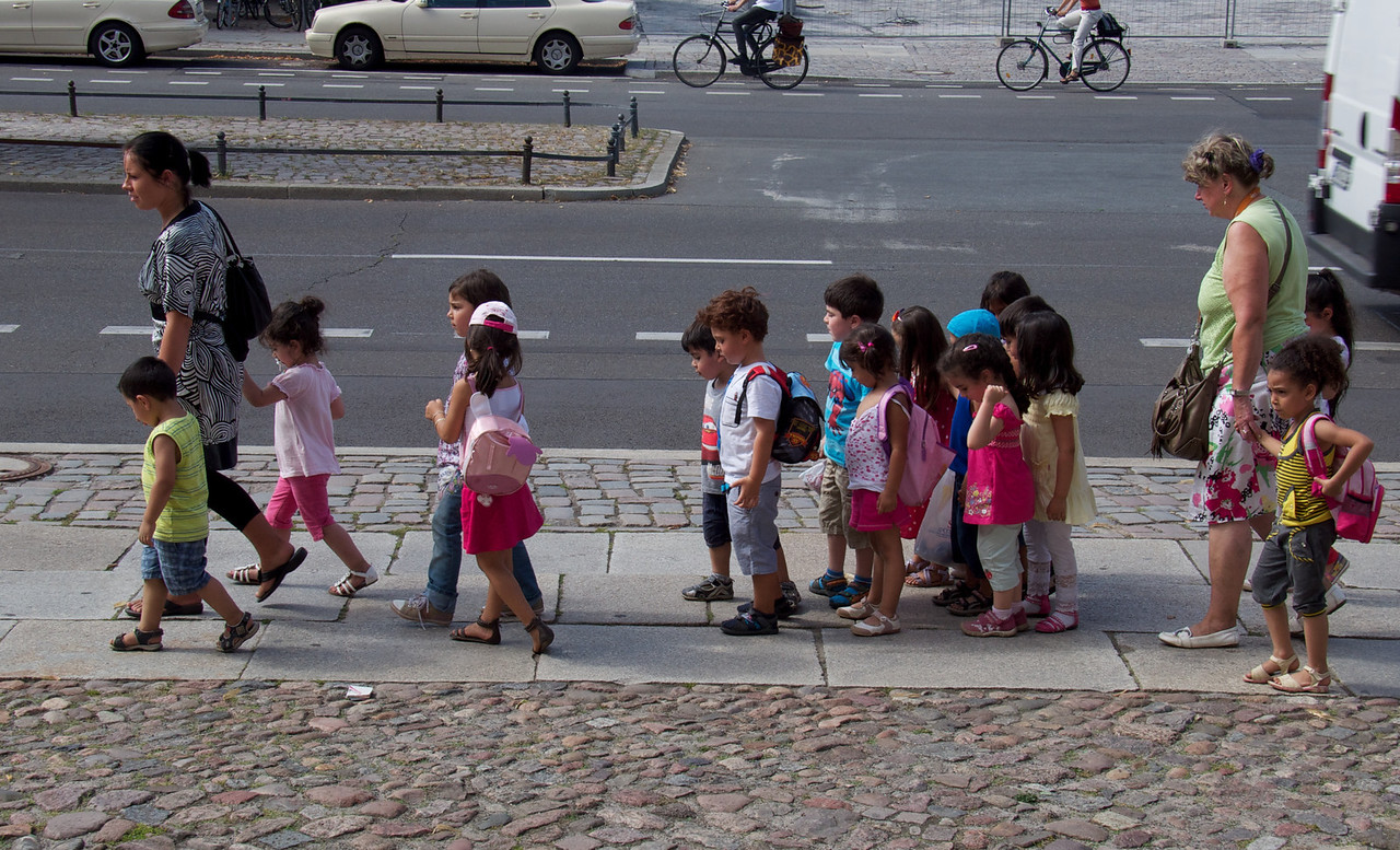 A class of young children walking down the street outside The Jewish Museum.