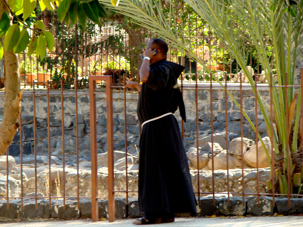Priest on Cell Phone at Capharnaum