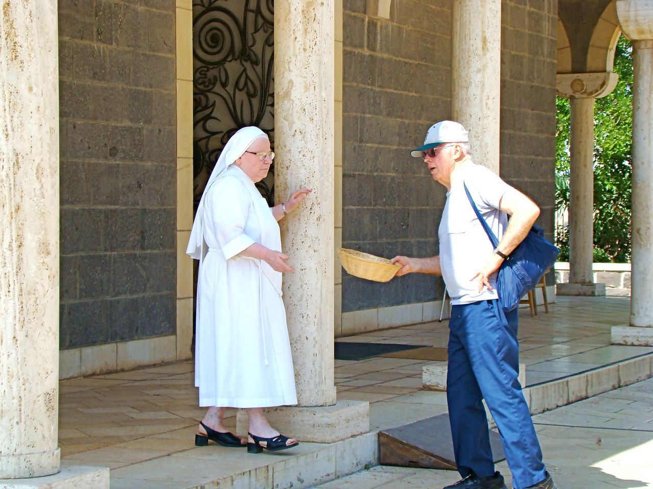 Nun Requiring Donation from Group