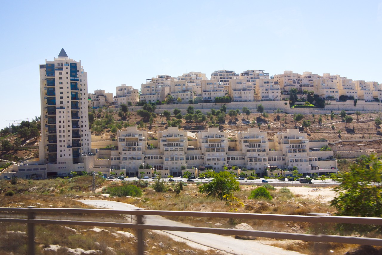 Har Homa neighborhood helps complete the southeastern perimeter between the Arab population of East Jerusalem and Palestinian towns to the south. (from bus)