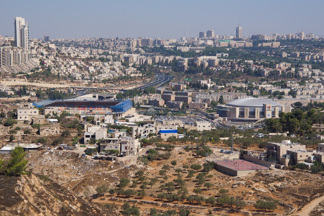 The two stadiums are inside the green line pre 1967 Jerusalem.