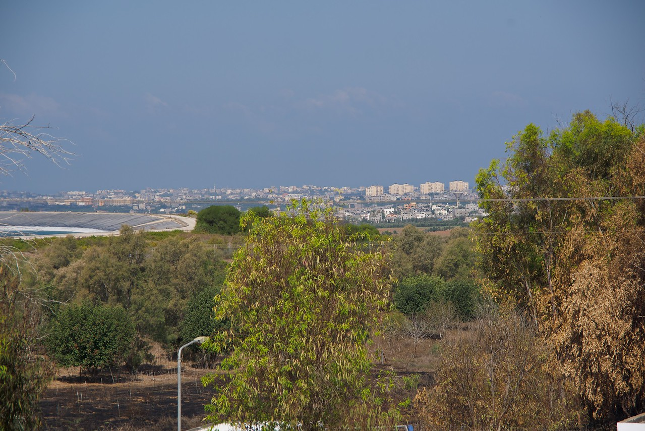 Looking into the Gaza Strip from N'san Yotzri Memorial and Nir Am Water Museum. Kibbutz reservoir mid left and Gaza Strip just beyond on right.