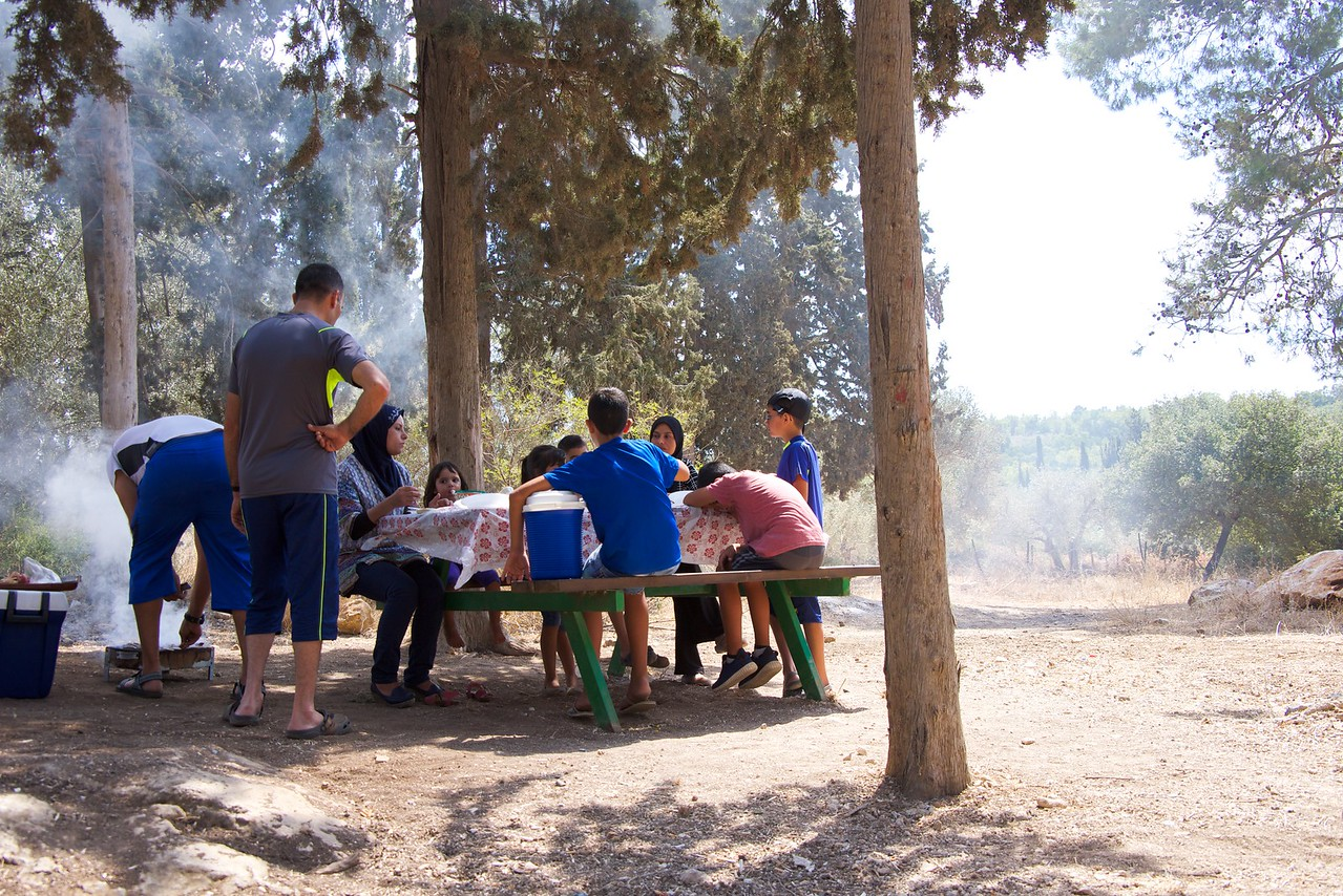 Family celebrating with a picnic. Holiday honors the willingness of Ibrahim to sacrifice his son Ishmael as an act of submission to God's command.