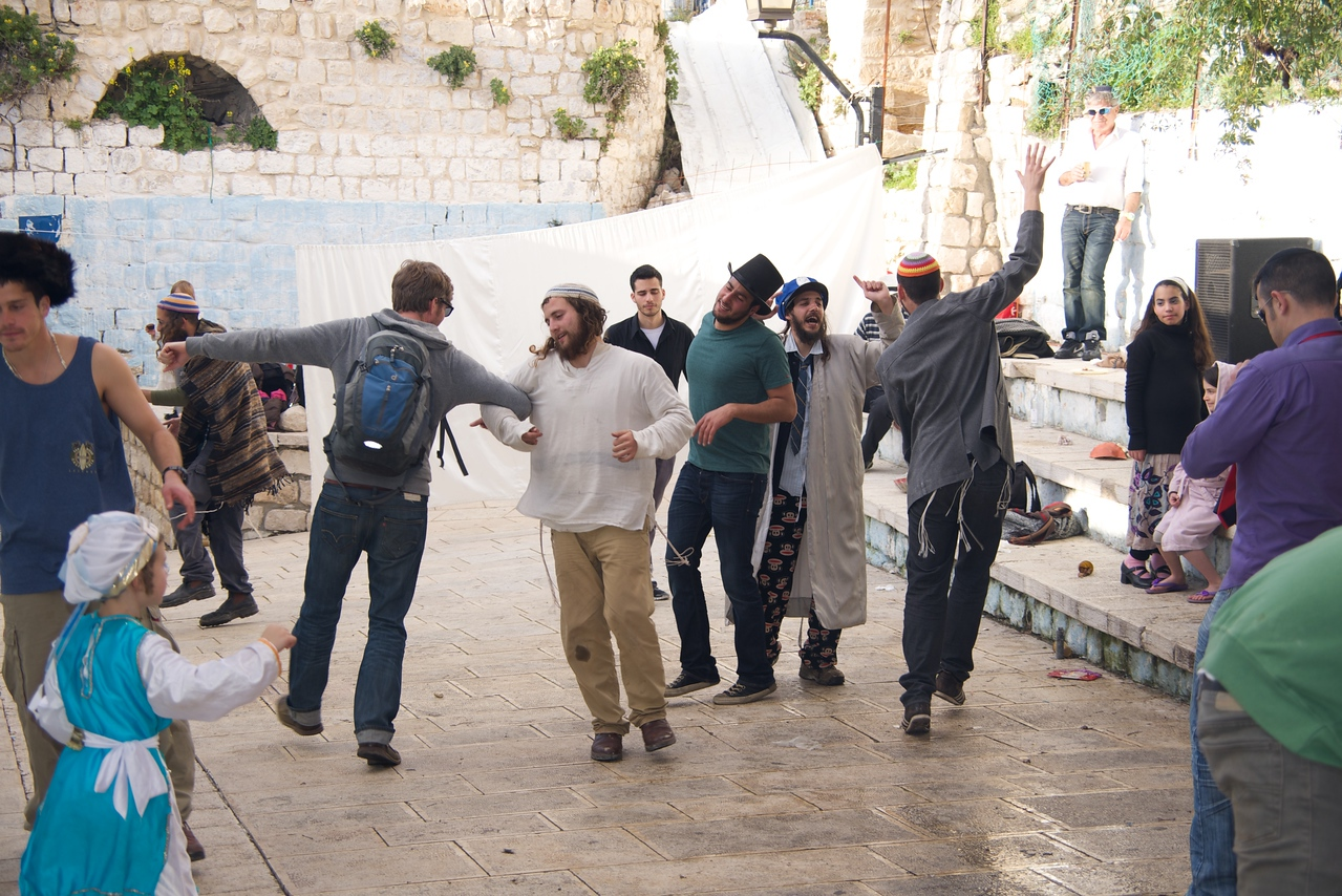 Men Dancing With Each Other... Women Behind The Screen.