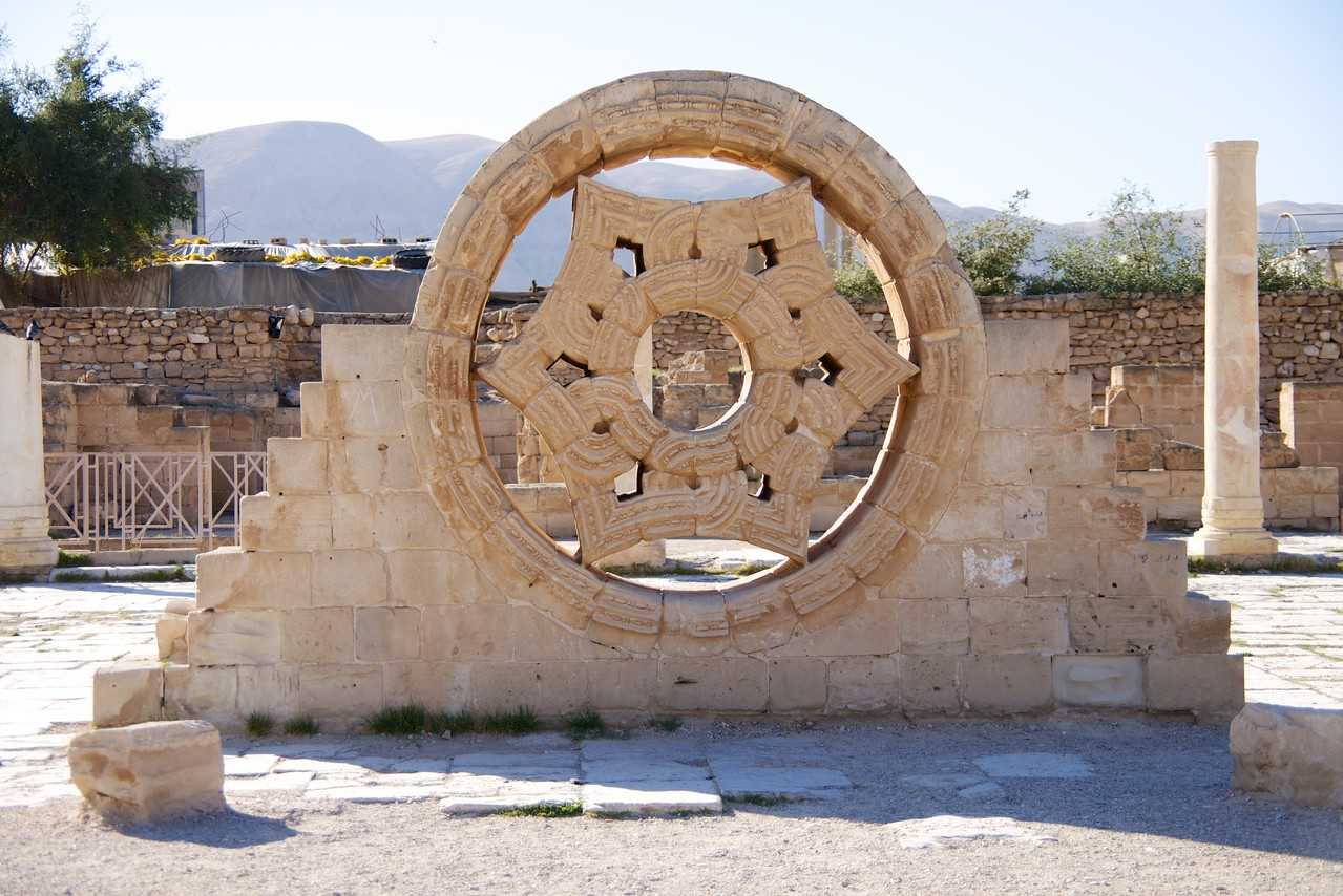 A Hexagonal star, built with sandstones inside a circular frame, and decorated with intricately engraved crossing geometrical forms, is thought to be an upper window of the Palace