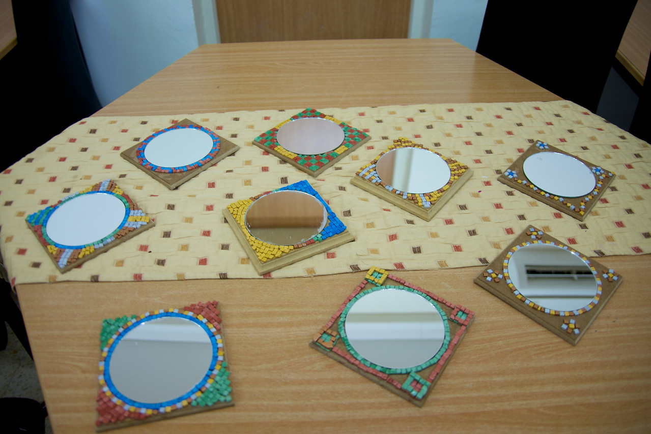 Art Projects by The Girls Participating in Warm Home Project  Used Mirrors to Broach The Subject of The Girls' Own Refelections