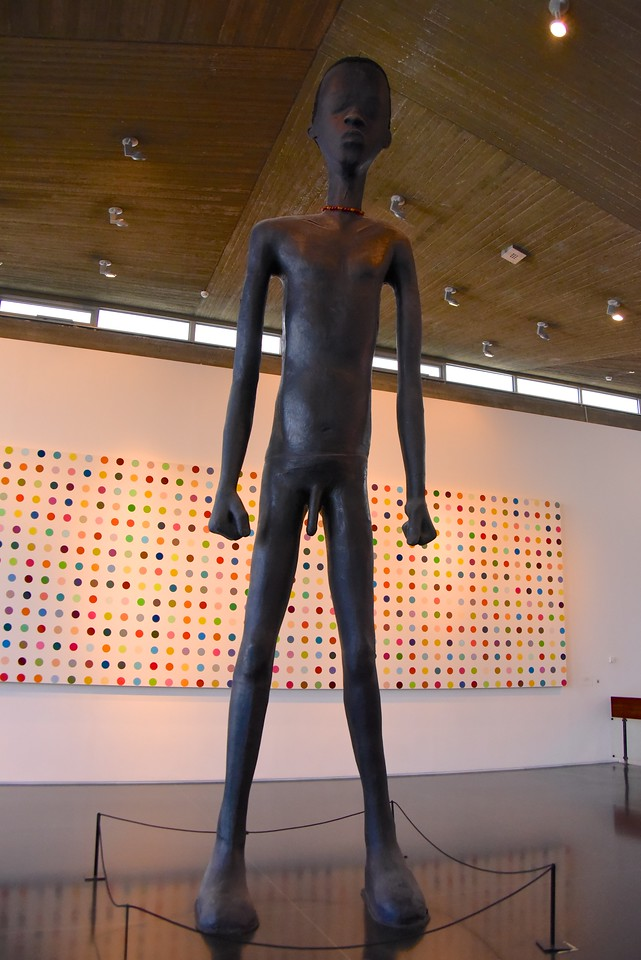 The Boy from South Tel Aviv by Ohad Meromi Expresses Dignity But Is A Political Statement About The Illegal Africans Coming To Israel  (Notable Elements Are Feet Planted Firmly On The Ground, Fisted Hands and Colored Beads at The Neck)
