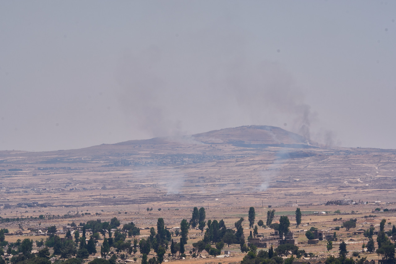 Smoke from Syrian rebels firing on each other.