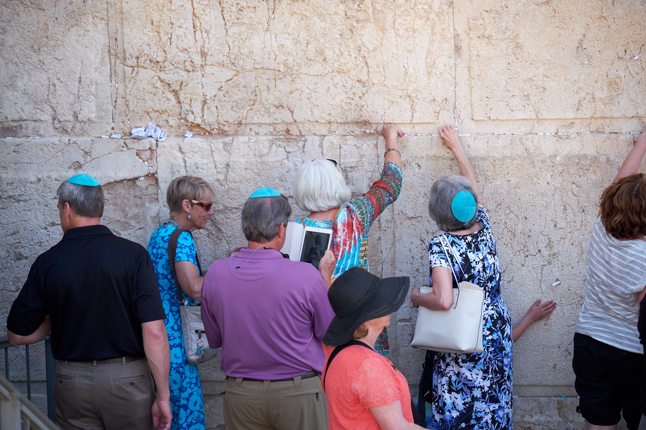 Placing prayers at the Western Wall after the Bat Mitzvah.