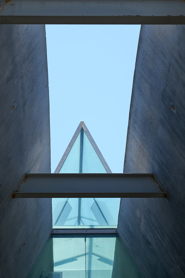 Yad Vashem is traingular concrete prism with a prism skylight that cuts through the mountain its sits on.