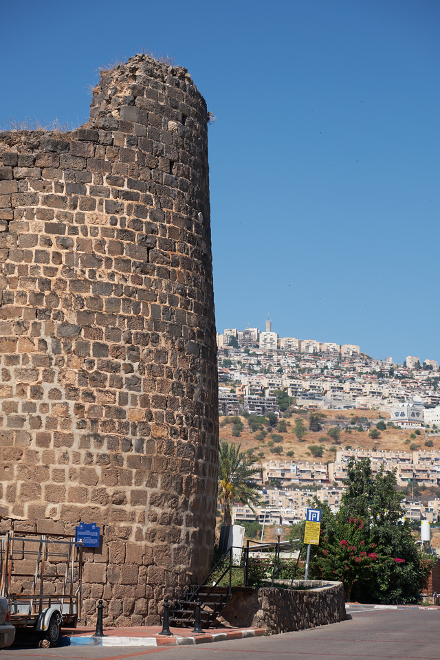 The Fortress, a two story building with 4 corner towers, is part of the Ottoman Wall around the city. Modern Tiberius on the hill.