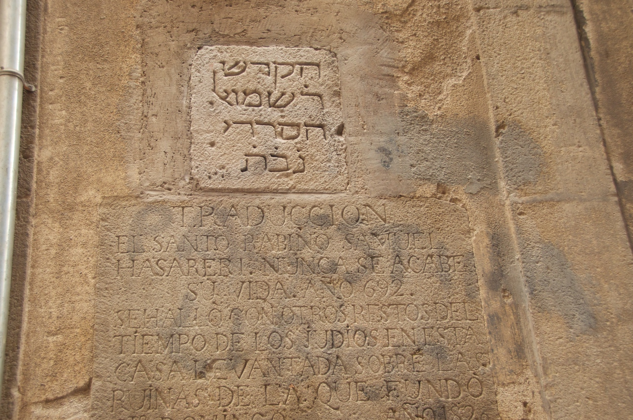 "Hebrew Plaque Is A Copy of The Original One… In 1820 The Owner of The Building Placed The Original Plaque and The Spanish Translation Below It…Black Graffiti Says ""Free Palestine"""