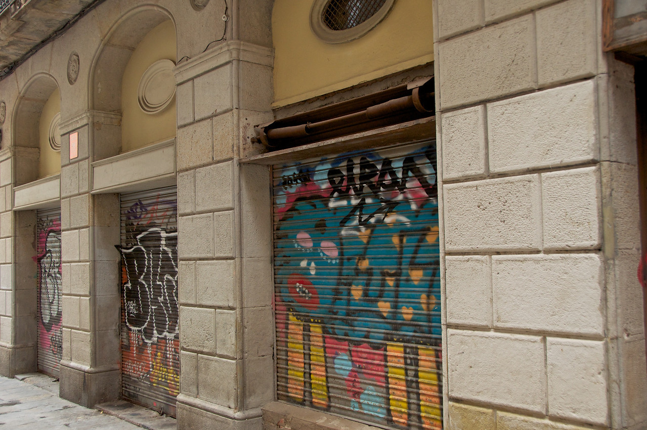 Buildings With Graffiti Are Now Used As Storage for Shops in The Area… People Live Above The First Floor