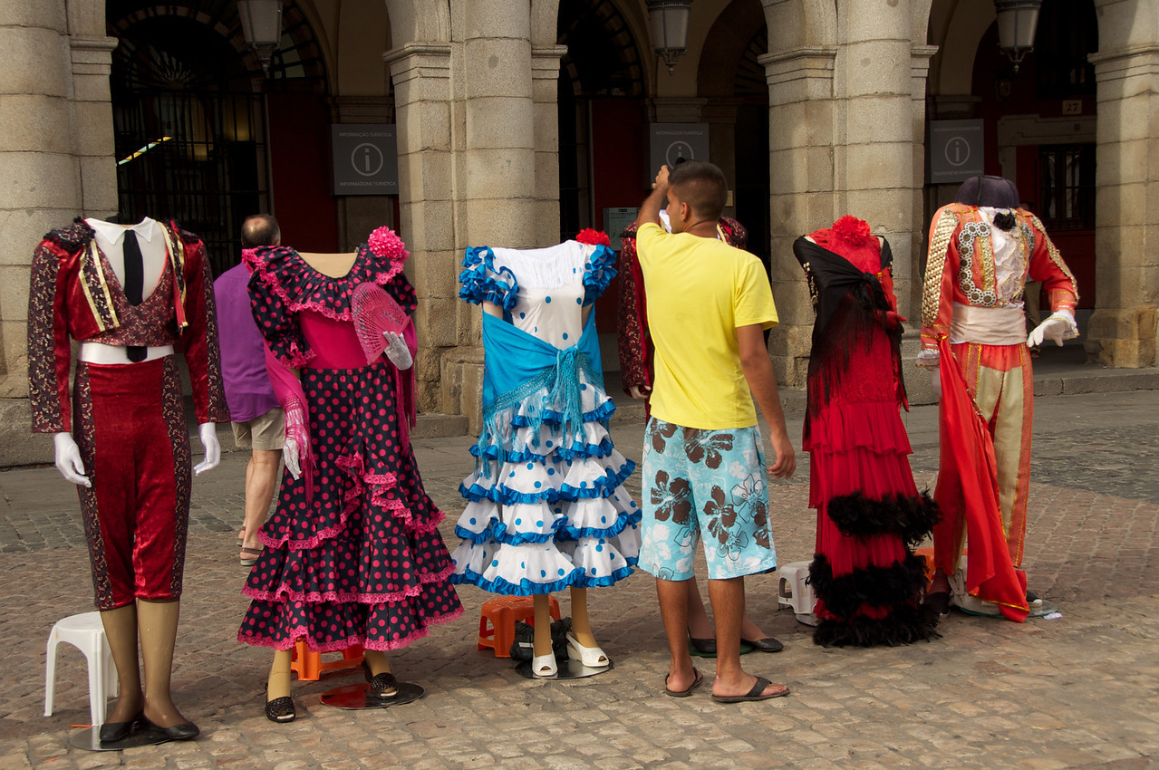 Spainish Costumes…People Pay To Stand Behind Them To Take Pictures…Commerce Alive and Well in Plaza Mayor