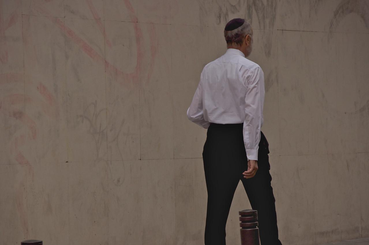 Local Walking Across Street From Restaurant (Near A Sefardi Synagogue)