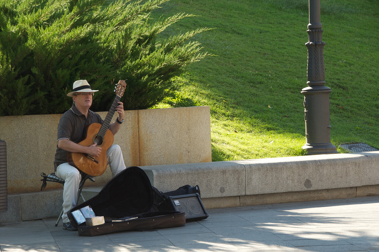 Guitarist Playing At Prado Entrance and Hawking His CD