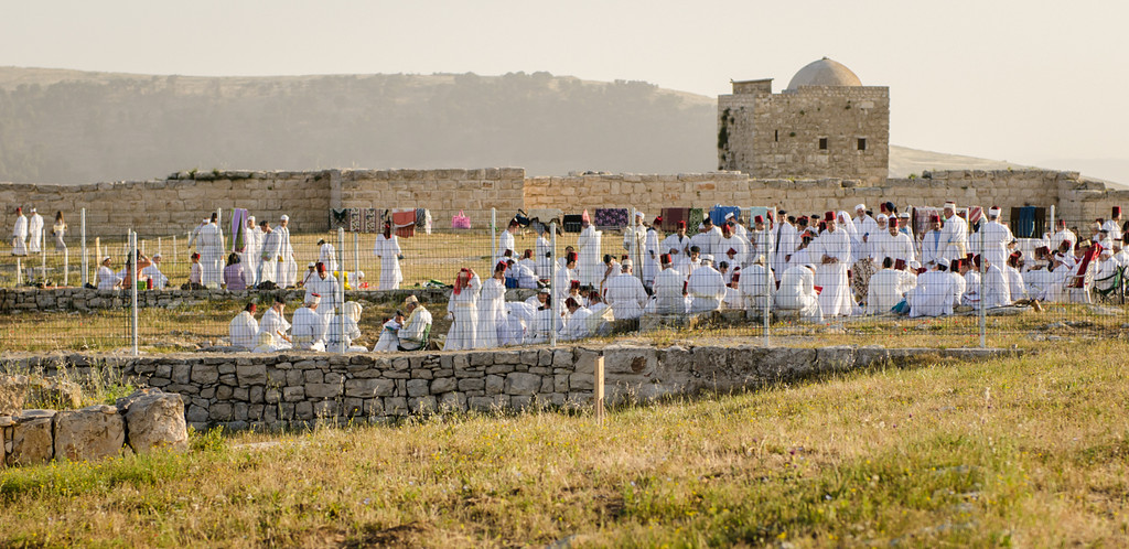At the conclusion of the processional, the Samarians are gathered at the last of seven stations, the Eternal Hill. The building in the background is a 12th century Moslem structure. The wall in the background was built for an octagonal Byzantine church.