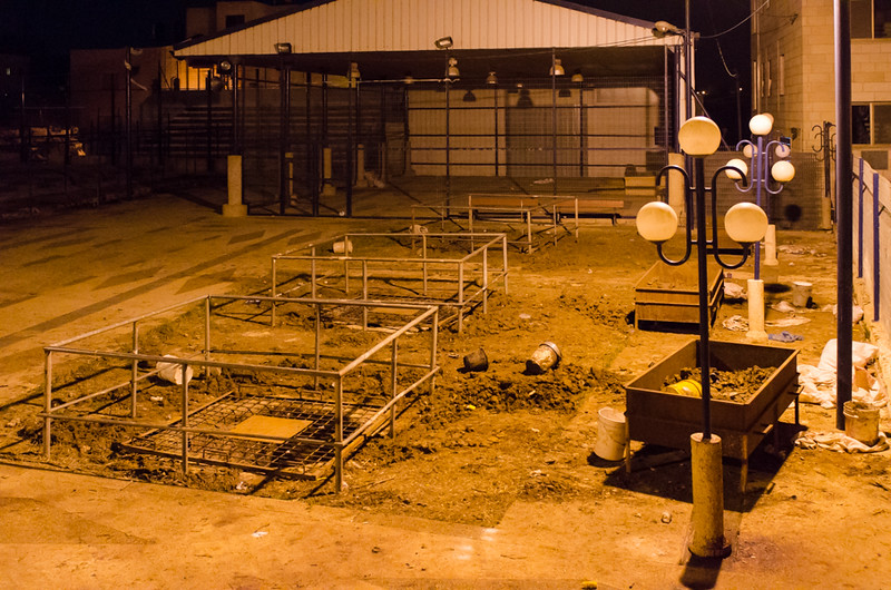 Three of the six pits where Passover lambs are sacrificed.  Approximately 8-9 sheep are sacrificed in each pit.  In 2013, fifty sheep were sacrificed. In 1967, only twelve sheep were sacrificed using two pits. As the community grows, more pits are being added.
