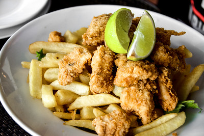 Chicharrón De Pollo  - chicken nuggets served with french fries