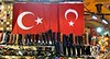 Shoes and boots and Turkish flags in a shoe shop in a market in Istanbul, Turkey in January 2014
