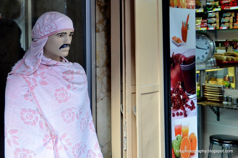 Mustached mannequin dressed in pink outside a store in the Grand Bazaar in Istanbul, Turkey in January 2014