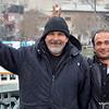 Two fishermen on the Galata Bridge in Istanbul, Turkey in January 2014