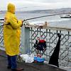 Fishing on the Galata Bridge in Istanbul, Turkey in January 2014