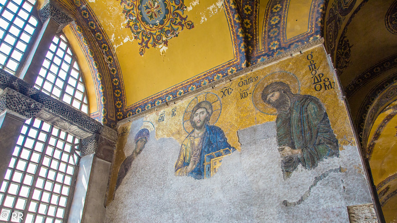 Deesis is a traditional representation of Virgin Mary and Saint John the Baptist, imploring Christ the salvation of man.<br /> It is widely considered the finest in Hagia Sophia, because of the softness of the features, the humane expressions and the tones of the mosaic. The style is close to that of the Italian painters of the late 13th or early 14th century, such as Duccio. In this panel the Virgin Mary and John the Baptist (Ioannes Prodromos), both shown in three-quarters profile, are imploring the intercession of Christ Pantocrator for humanity on Judgment Day. The bottom part of this mosaic is badly deteriorated. This mosaic is considered as the beginning of the Renaissance in Byzantine pictorial art.