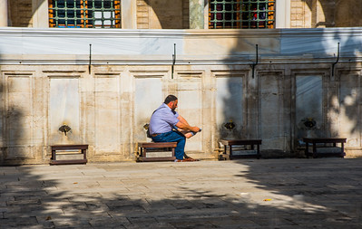 Man washing feet outside Mosque, Istanbul