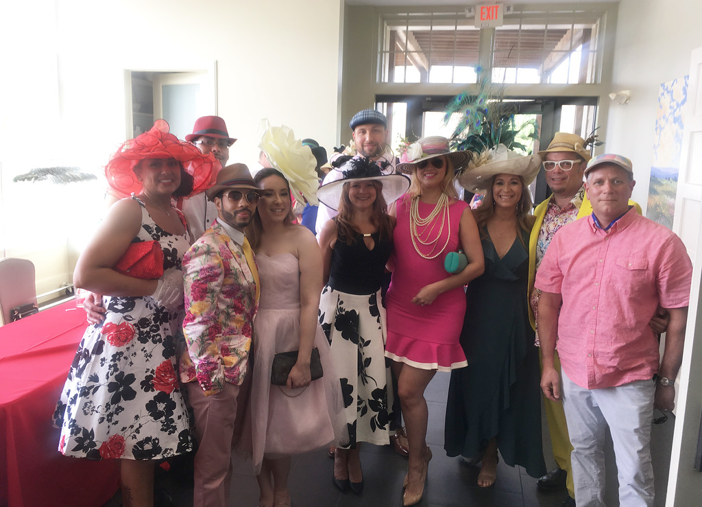 . Ladies and gents attend the Derby party at Four Oaks.