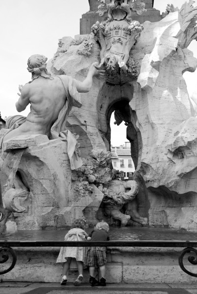Twins playing in Bernini's Fontana dei Quattro Fiumi (Fountain of Four Rivers), Piazza Navona, Roma, 2009.