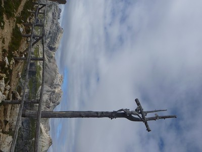 We reached Passo Crespeina [8,293'] and its artistic crucifix.
