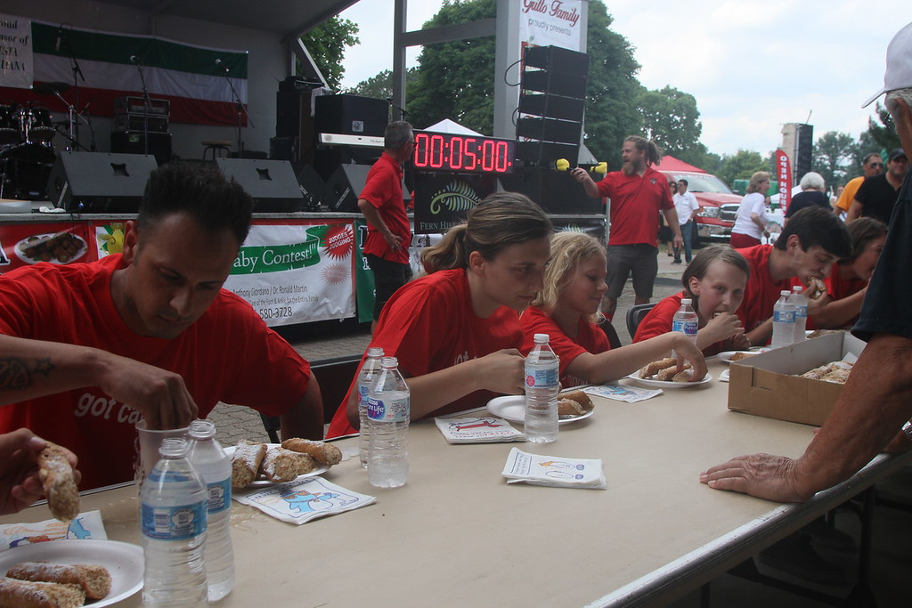 . In addition to food and music, Festa Italiana also hosted several contests including the beautiful baby contest and this -- cannoli-eating contest shown here.