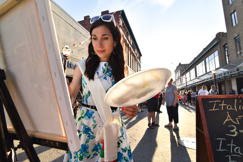 (06/02/18) Ylenia Mino, originally from Italy, creates a work of art in the center of Saturday;s Italian Festival held in Downtown Fitchburg.  SENTINEL & ENTERPRISE JEFF PORTER