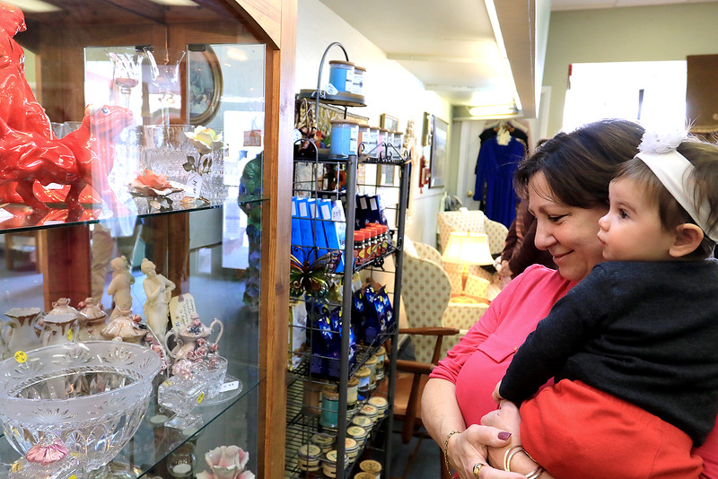 A ribbon cutting for Italian Treasures in Leominster was held on March 8, 2019. Joanne Liberatore and her granddaughter Coralina Kashmanian, 10 months old, looks over some of the stuff for sale in the new shop. SENTINEL & ENTERPISE/JOHN LOVE