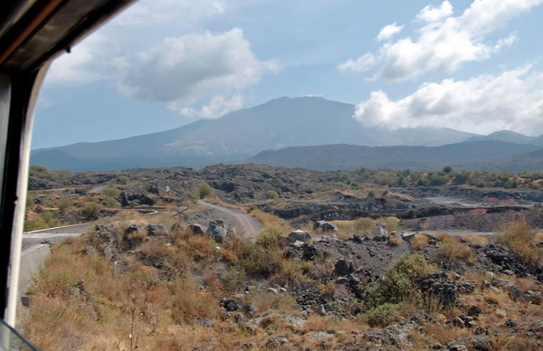 Welcome to the Ferrovia Circumetnea (FCE)!    Looking east to Etna (3340m), from between Bronte and Randazzo.