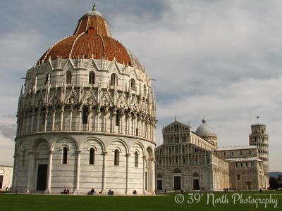 Constructed on the same unstable sand as the Tower, the Baptistry (left) leans 0.6 degrees toward the cathedral. It's the largest baptistry in Italy.