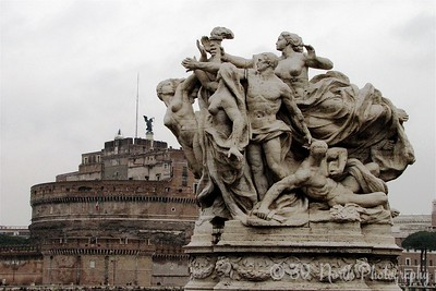 Castel Sant'Angelo (background) and a statue on a bridge.